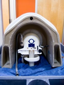 Flushometer inside the Sloan Hybrid Urinal